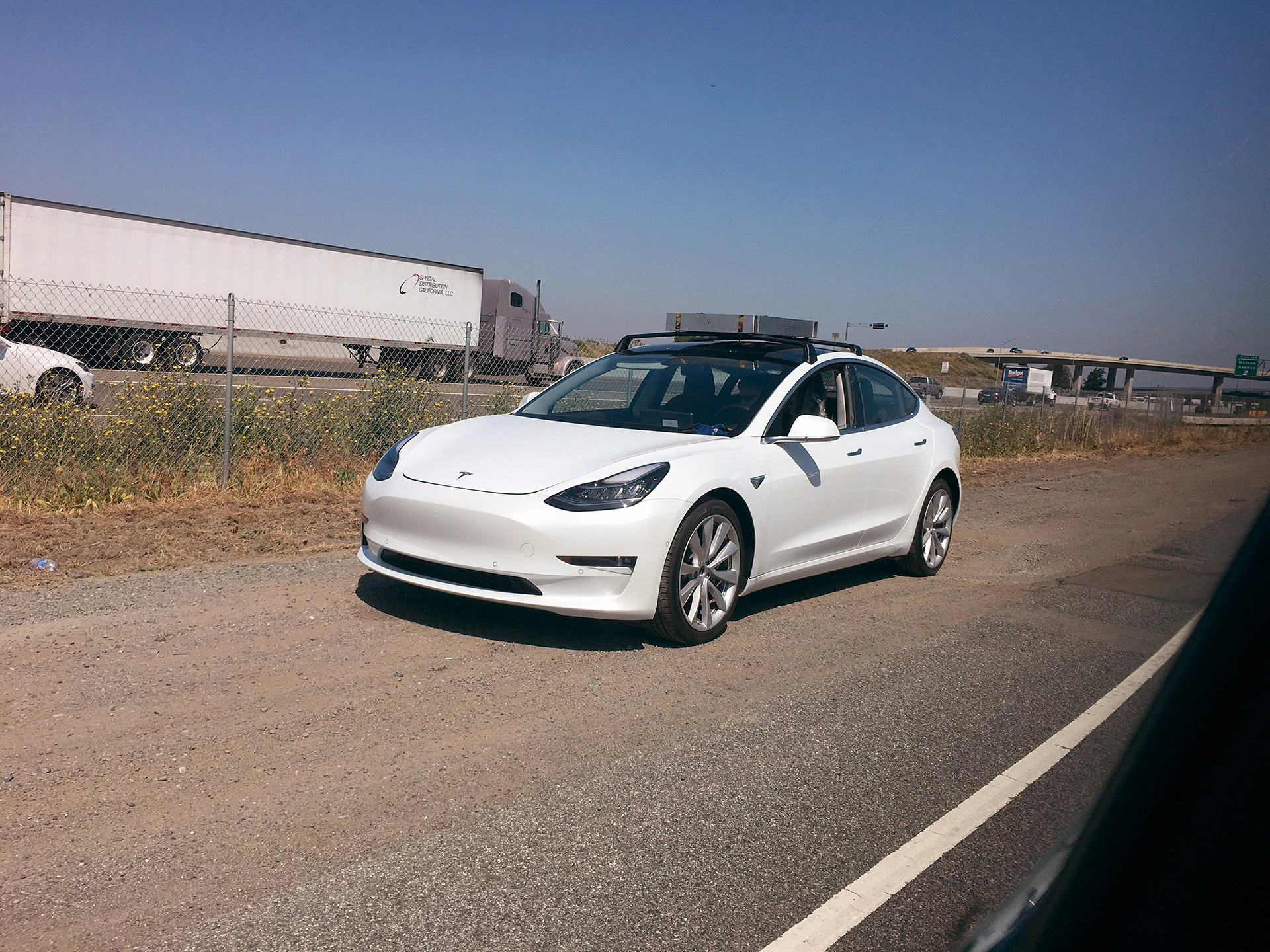 White Tesla Model 3 Spotted With Roof Rack System