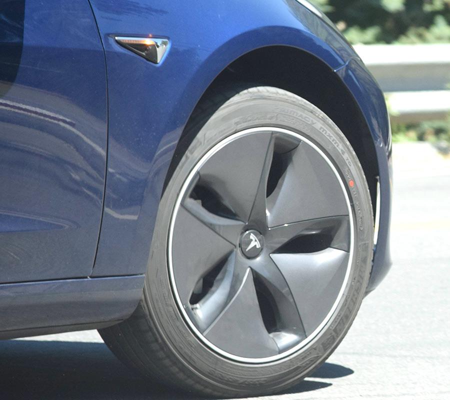 Tesla Model 3 Aero Wheels On A Blue Release Candidate
