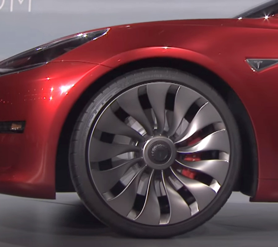Red Tesla Model 3 with Wind-Turbine Wheels At The Unveil Event