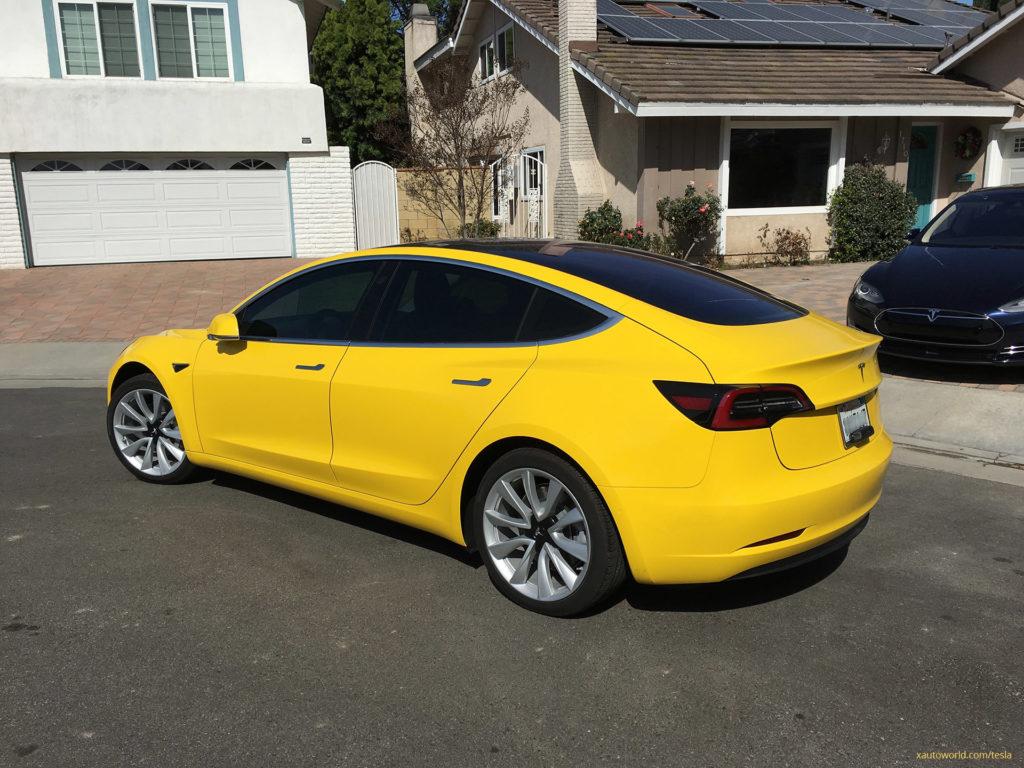 Yellow Tesla Model 3 - Rear Side View