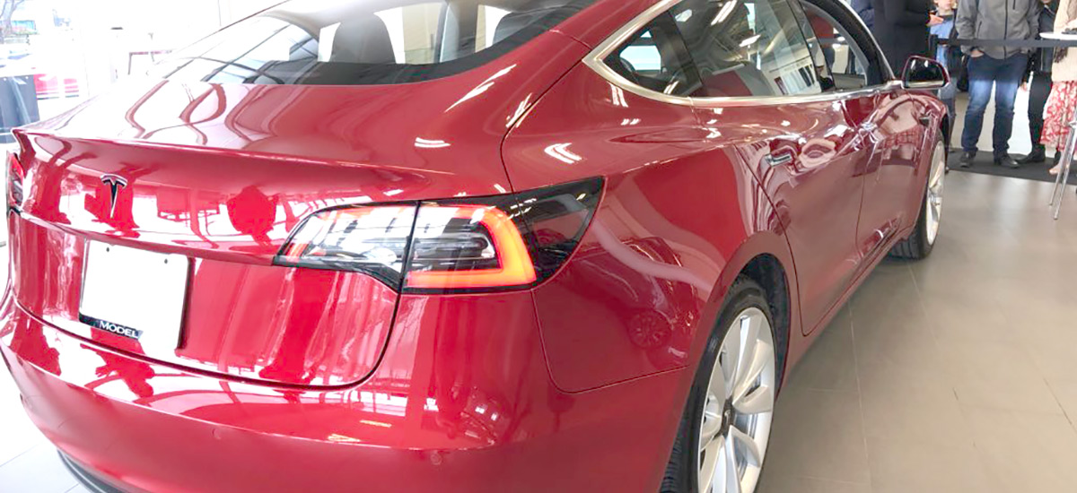 Red Tesla Model 3 at Tesla Store Montreal, Canada