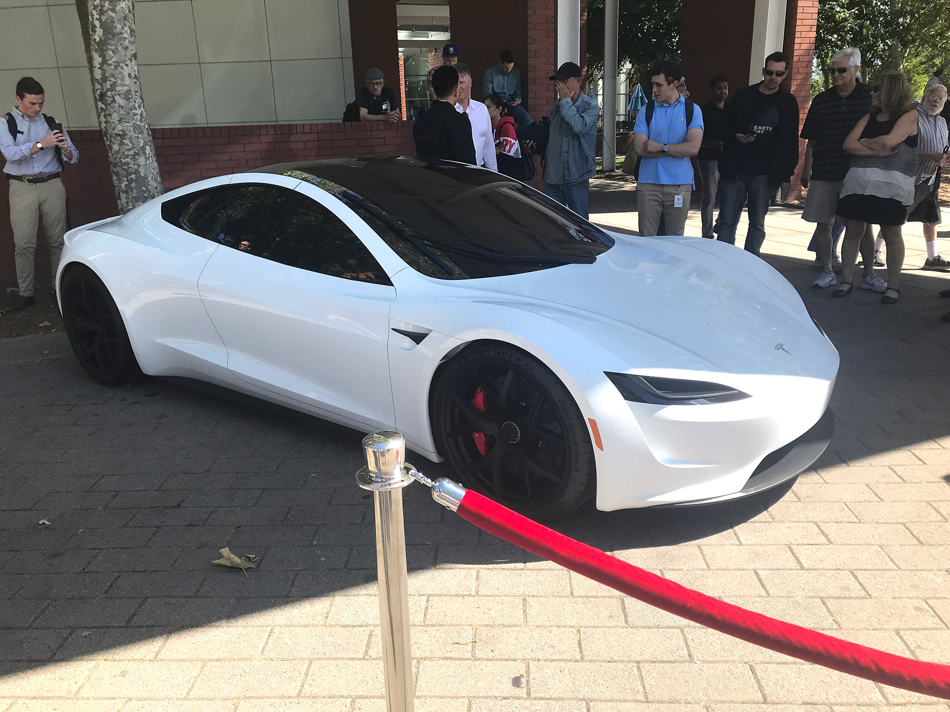 Gallery White Tesla Roadster And Semi Truck At The 2018 Tesla