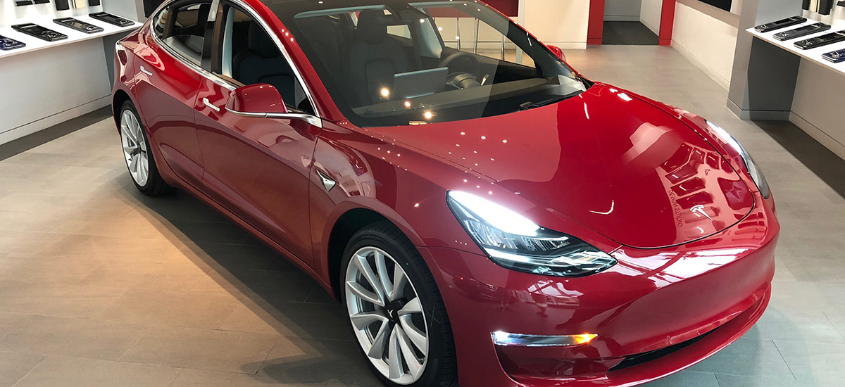 Red Tesla Model 3 at the Tesla Design Studio in Jacksonville, FL