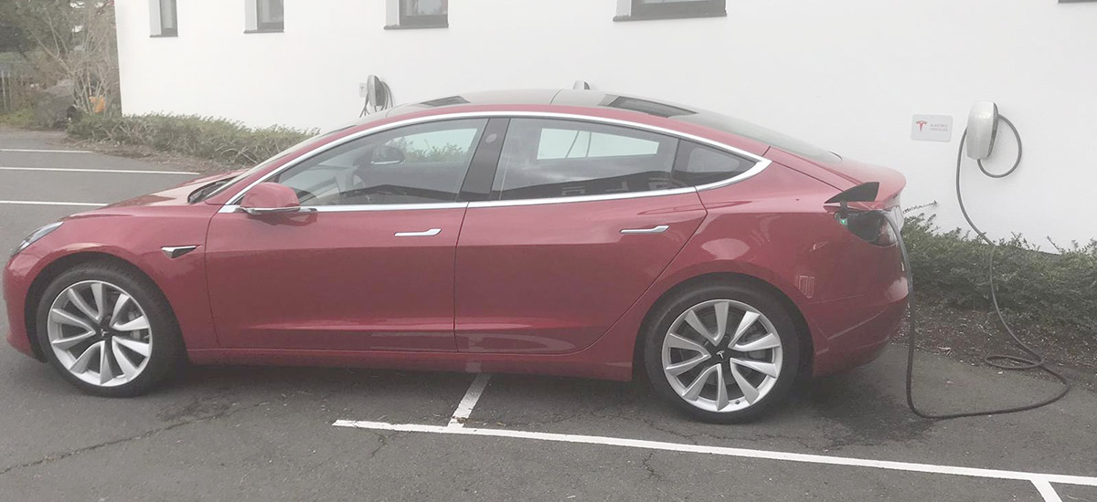 Model 3 spotted charging at Tesla Grohmann Germany