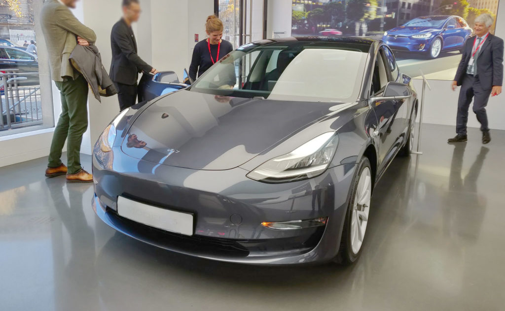 Tesla Model 3 in Mindnight Silver Metallic on display at the Tesla Store in Paris France