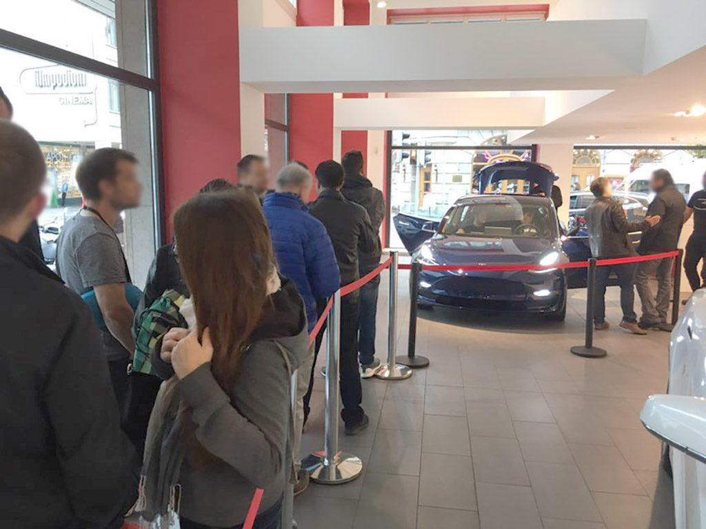 Tesla Model 3 on display in Sweden - People waiting for their turn to experience the Model 3