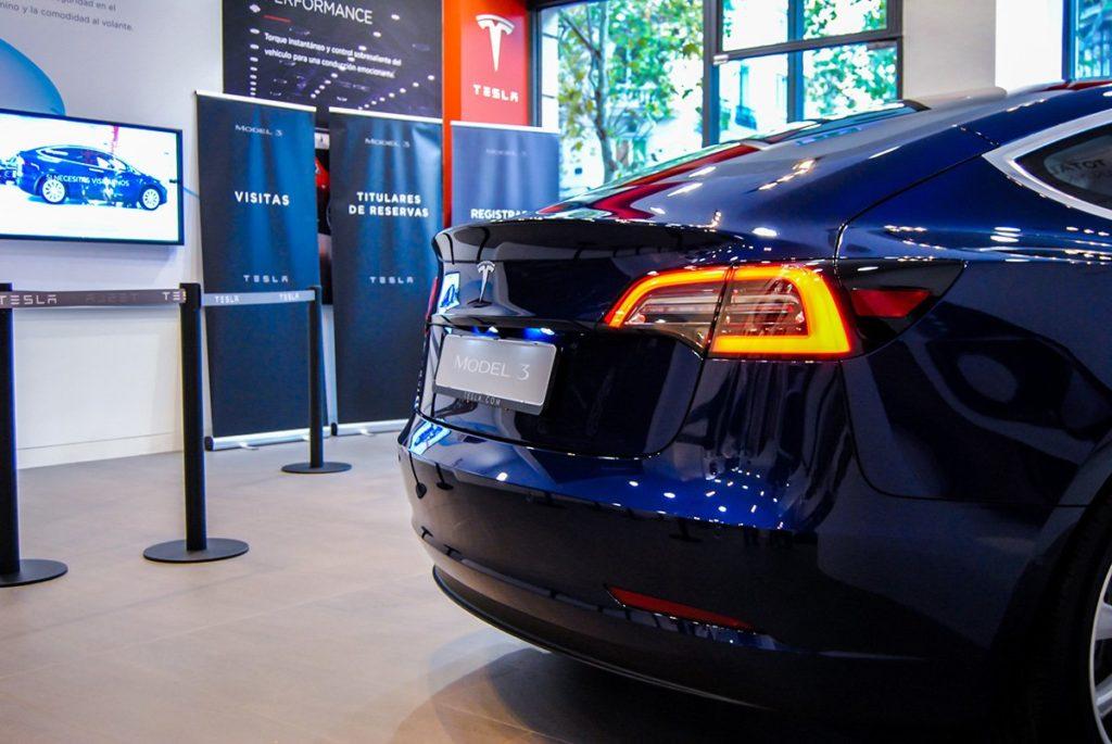 Blue Tesla Model 3 in Madrid, Spain - Rear Side View