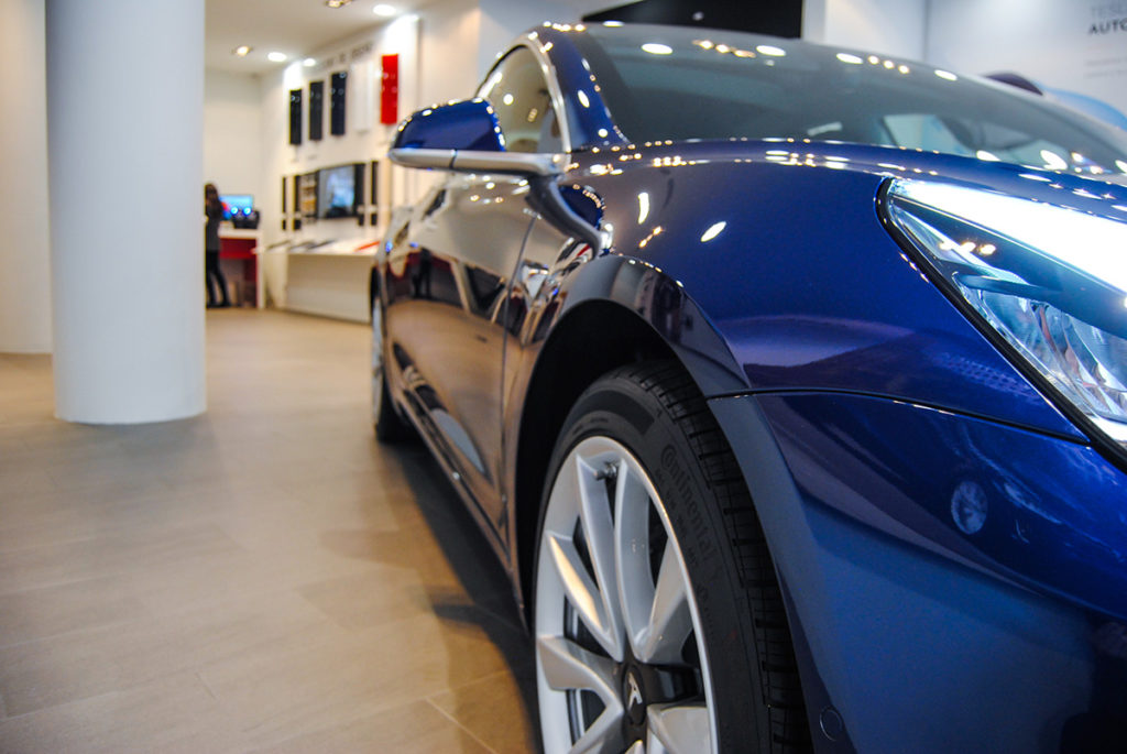 Blue Tesla Model 3 in Madrid, Spain - Front Partial Closeup