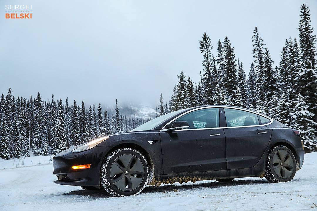 Black Tesla Model 3 in Snow - Front Side View