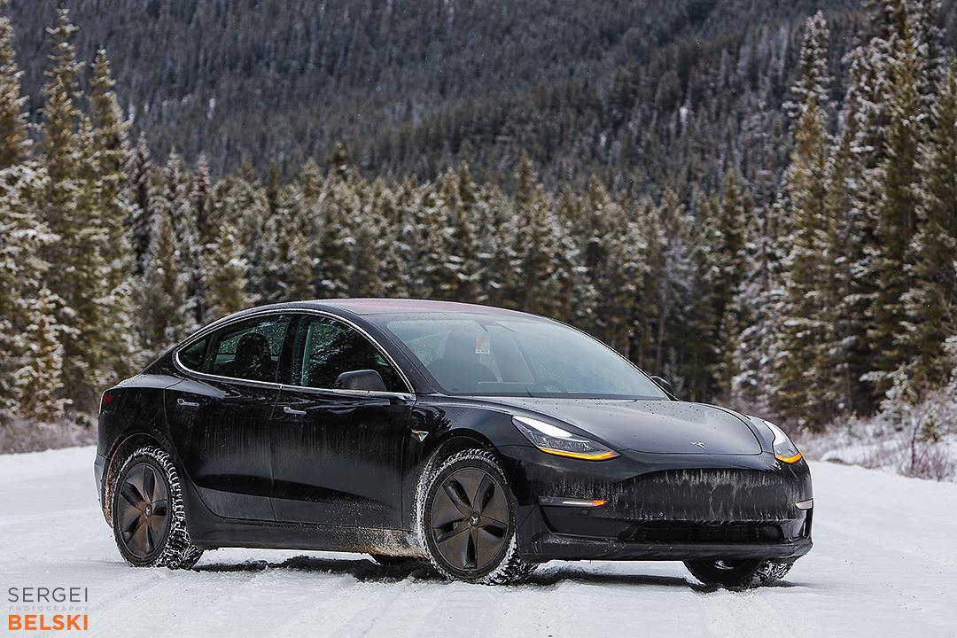 Black Tesla Model 3 in Snow - Front View