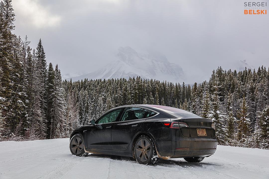 Black Tesla Model 3 in Snow - Rear