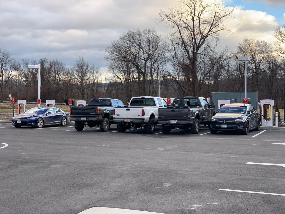 Tesla Supercharger blocked by Hillbilly Pickup Trucks