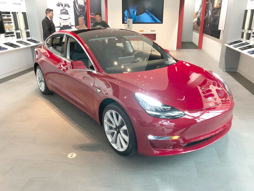 Red Tesla Model 3 at the Jacksonvlle, FL Tesla Store ready for delivery - Front Shot