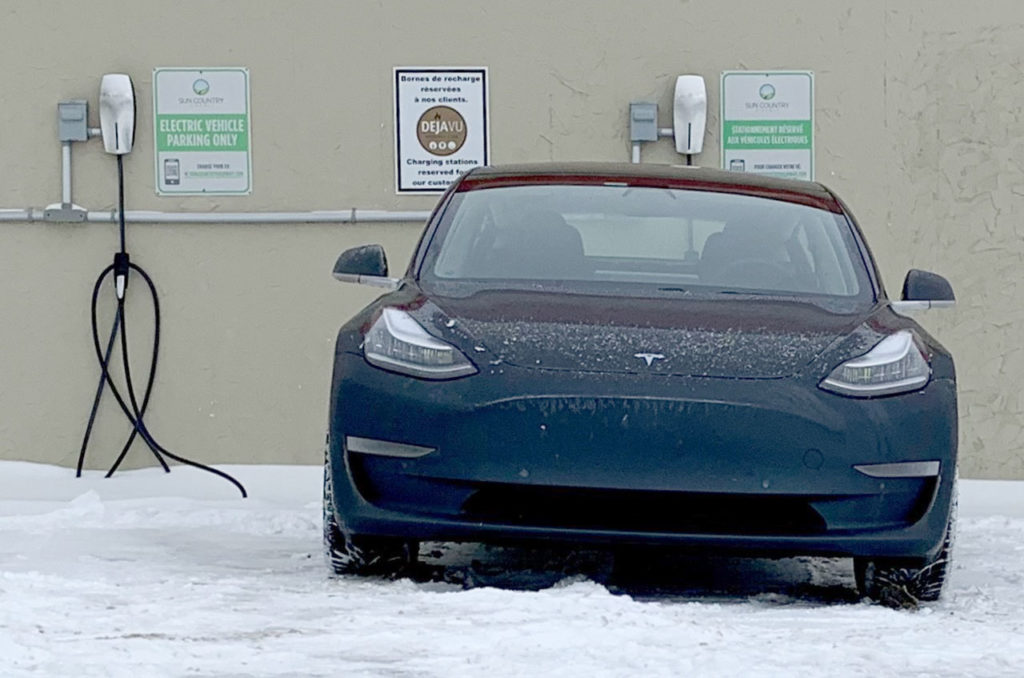 Tesla Model 3 Performance (Magneto) charging outside a restuarant in Hawkesbury Ontario, Canada
