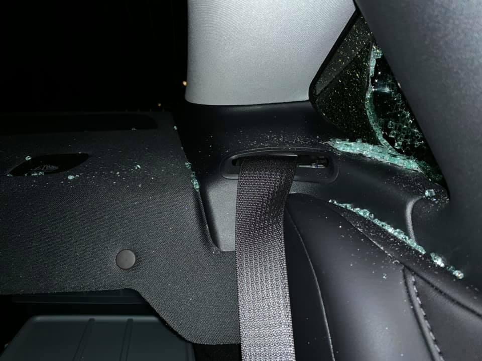 Tesla Model rear quarter window break-in - a look from inside the car