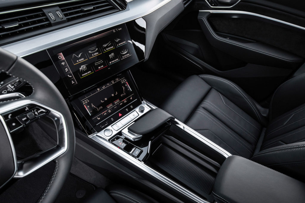 Audi e-tron interior - center touchscreens and gear shifter, center armrest