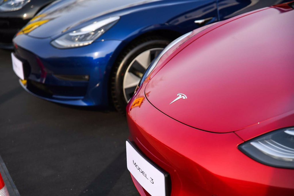 Red and Blue Tesla Model 3 at the Goldenport Race Circuit in Beijing, China
