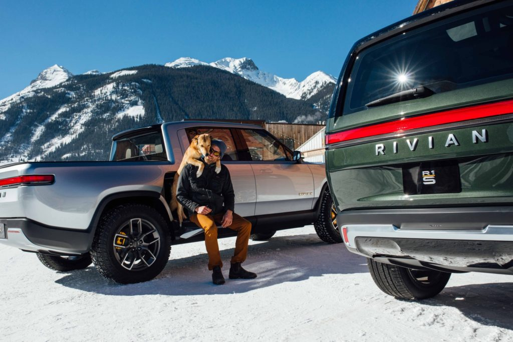 Sitting on the Rivian R1T Pickup Truck's gear tunnel door when open, gives ease of tying your shoelaces