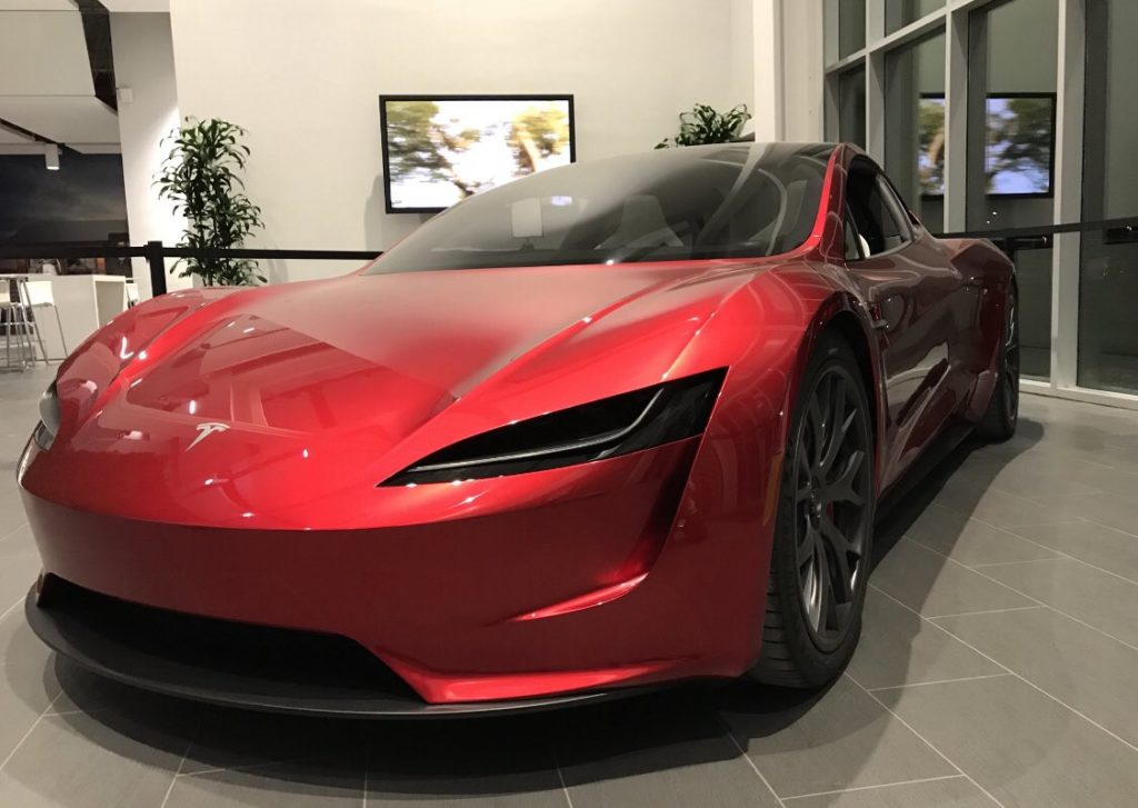 Next-gen Telsa Roadster in red color at a Tesla facility - front closeup