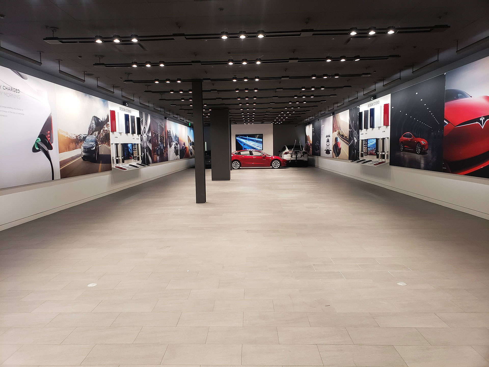 An almost empty Tesla Store, getting ready for transition to the online sales model.