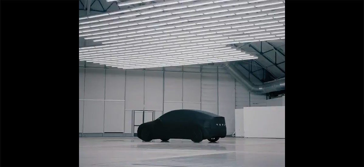 Tesla Model Y under cover teased just hours before the unveil