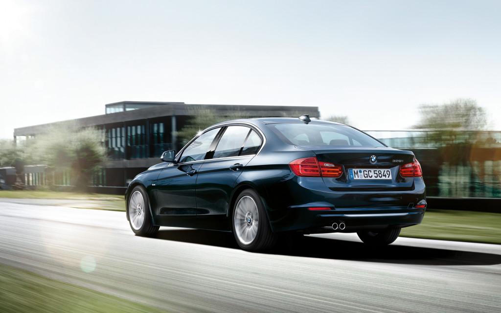 BMW 3 Series In Dark Blue Rear View Wallpaper