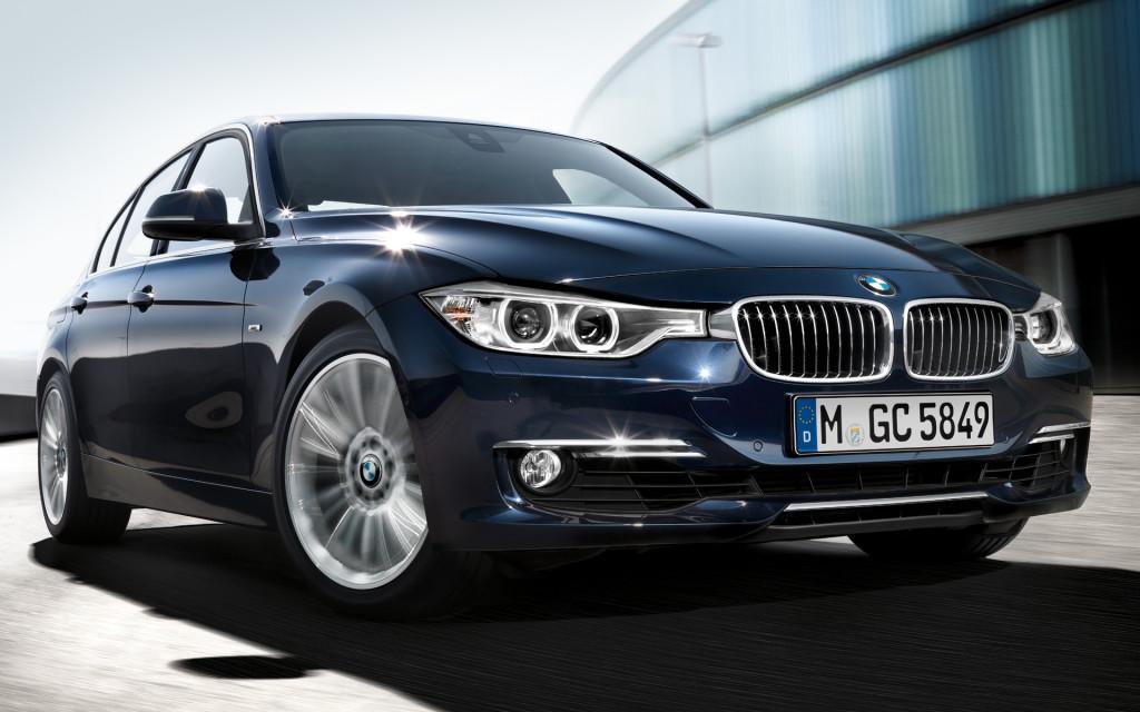 BMW 3 Series In Dark Blue Front Closeup Wallpaper