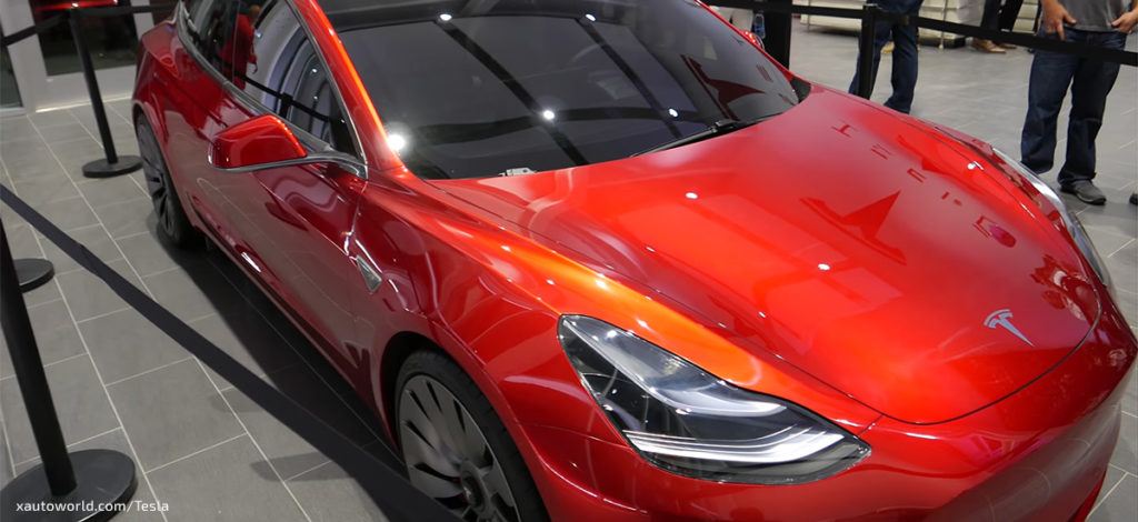Tesla Model 3 Ornage HD Photos