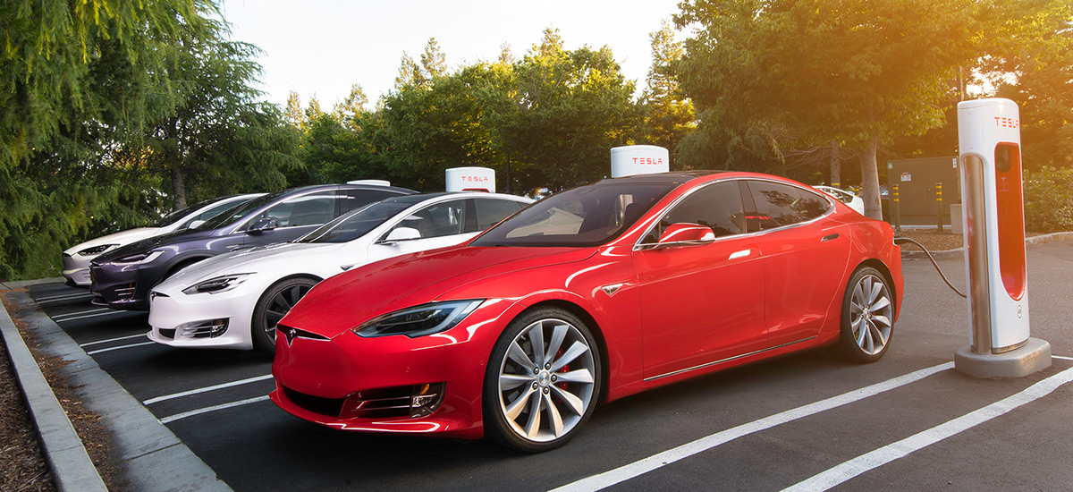 Tesla Supercharger idle fee - $0.40/min. FAQ and Coutry-wise fee info