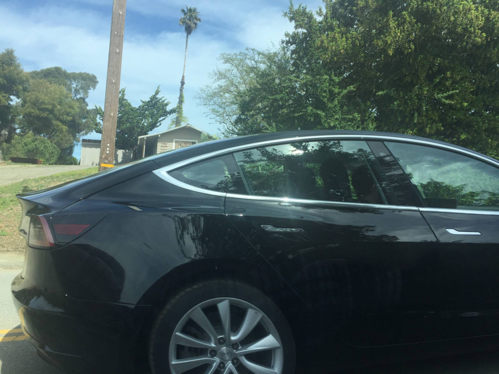 Black Model 3 caught testing - Rear Side View