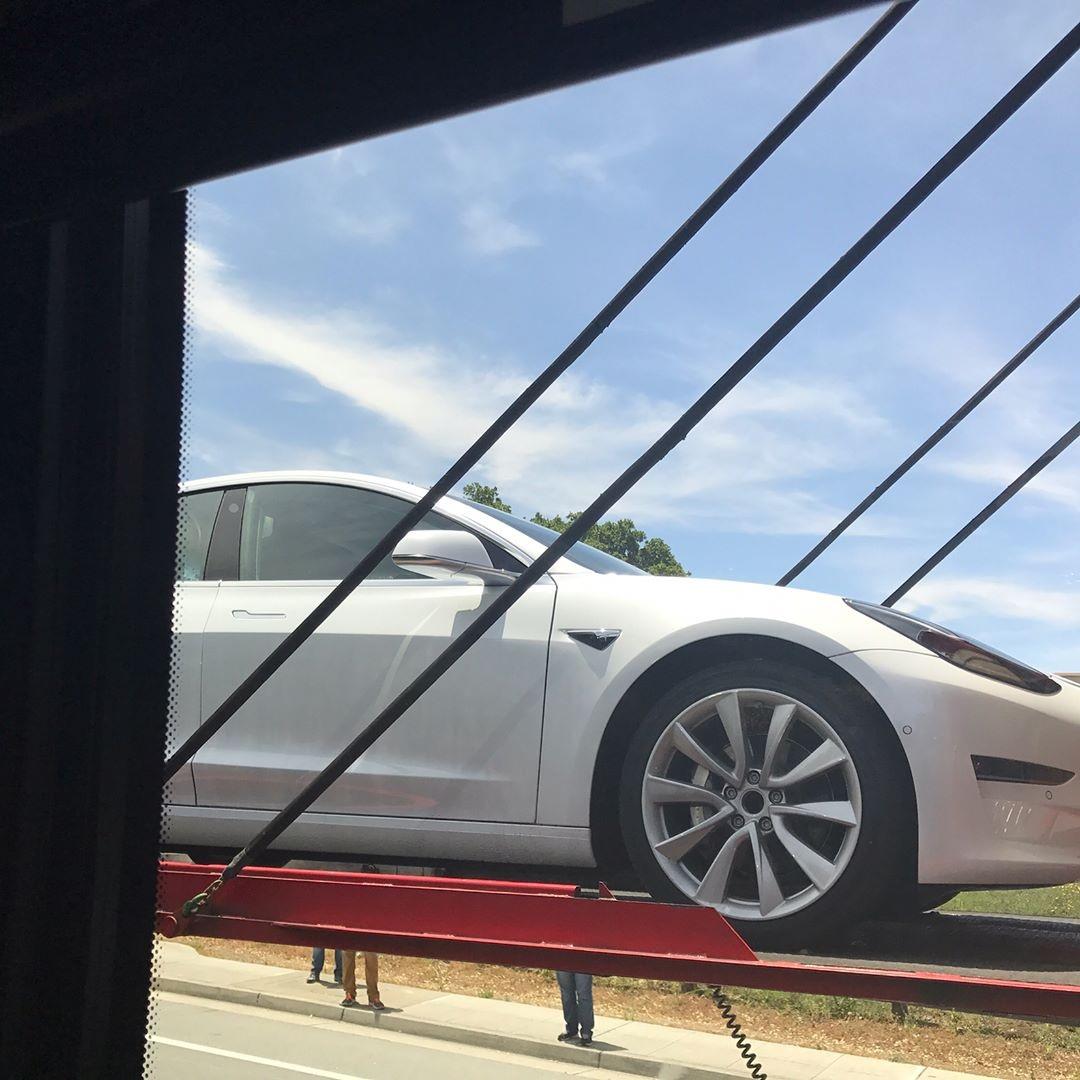 Tesla Model 3 unloading closeup front photo