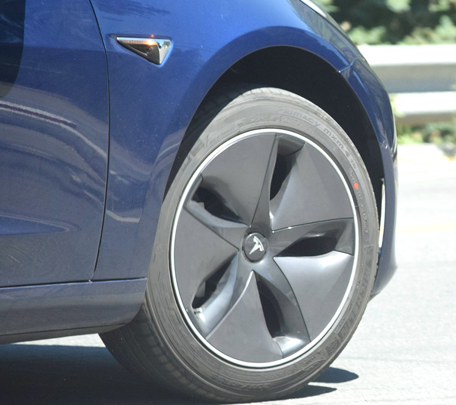 Tesla Model 3 Aero Wheels On A Blue Release Candidate