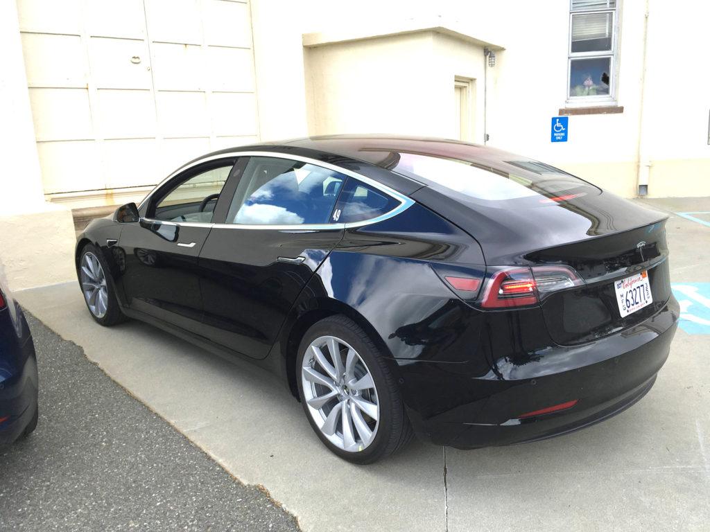 Black Tesla Model 3 after test driving on a Sunday