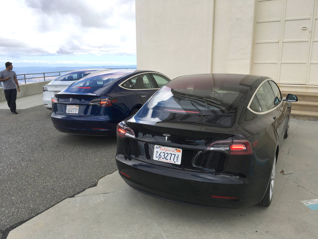 Three Tesla Model 3 after test driving on a Sunday