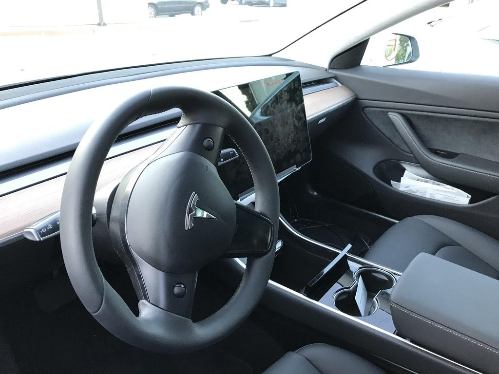 Tesla Model 3 steering and screen closeup view