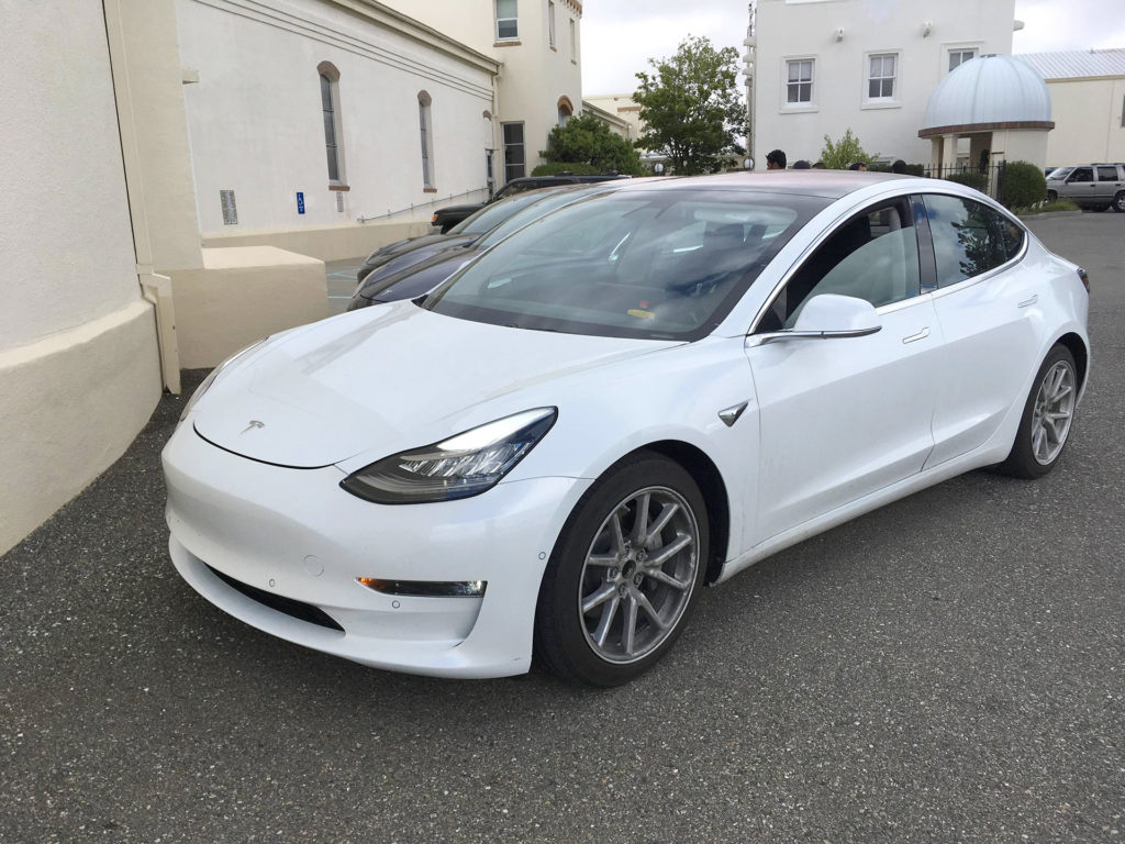 White Tesla Model 3 after test driving on a Sunday - Frunk and bumper gap is fairly visible