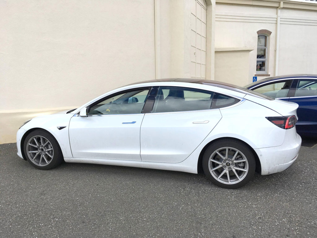 White Tesla Model 3 after test driving on a Sunday