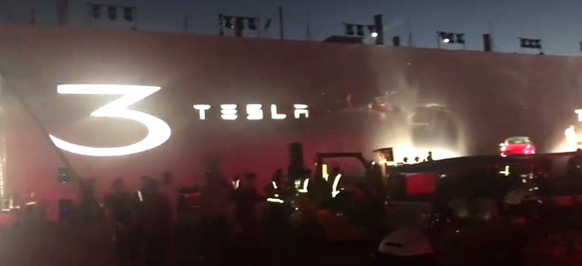 Model 3 delivery party stage being setup by Tesla