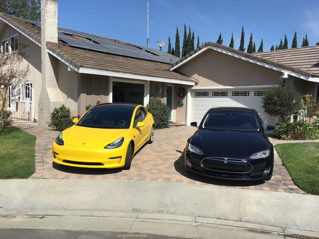 Yellow Tesla Model 3 - Standing with Black Model S