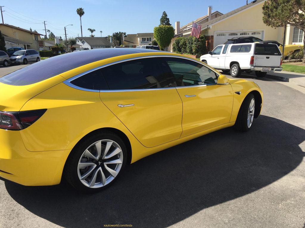 Yellow Tesla Model 3 - Rear Side View 2