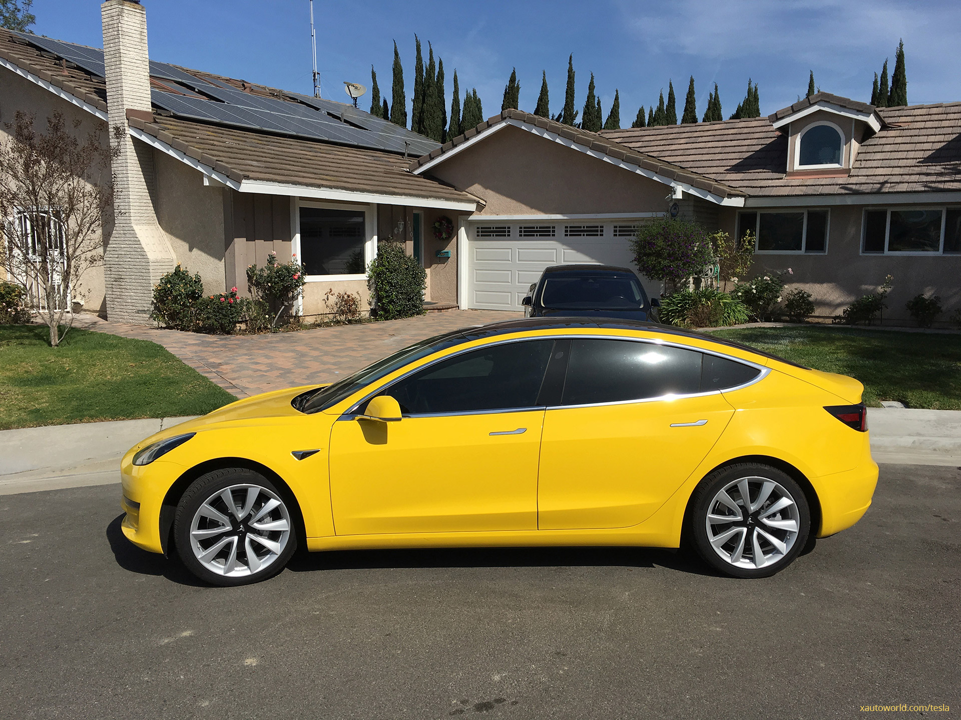 Yellow Tesla Model 3 - Side View