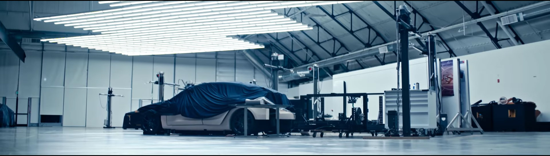 Half covered vehicle in Tesla 2018 video, probably Model Y