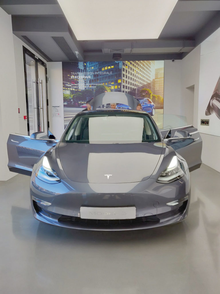 Tesla Model 3 in Mindnight Silver Metallic on display at the Tesla Store in Paris France