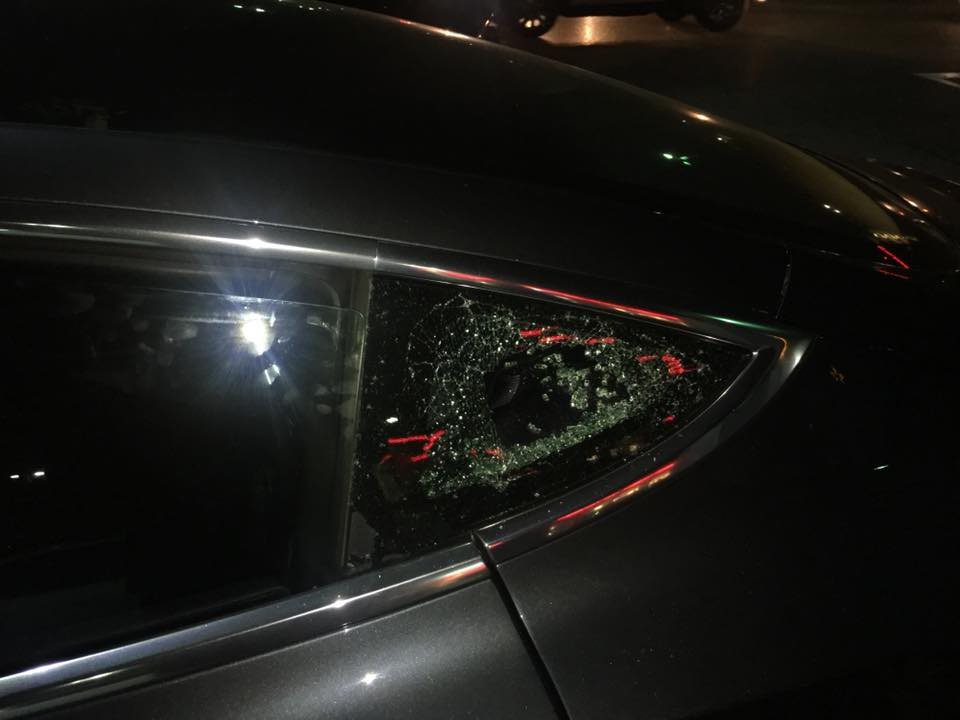 Black Tesla Model 3s window break-in