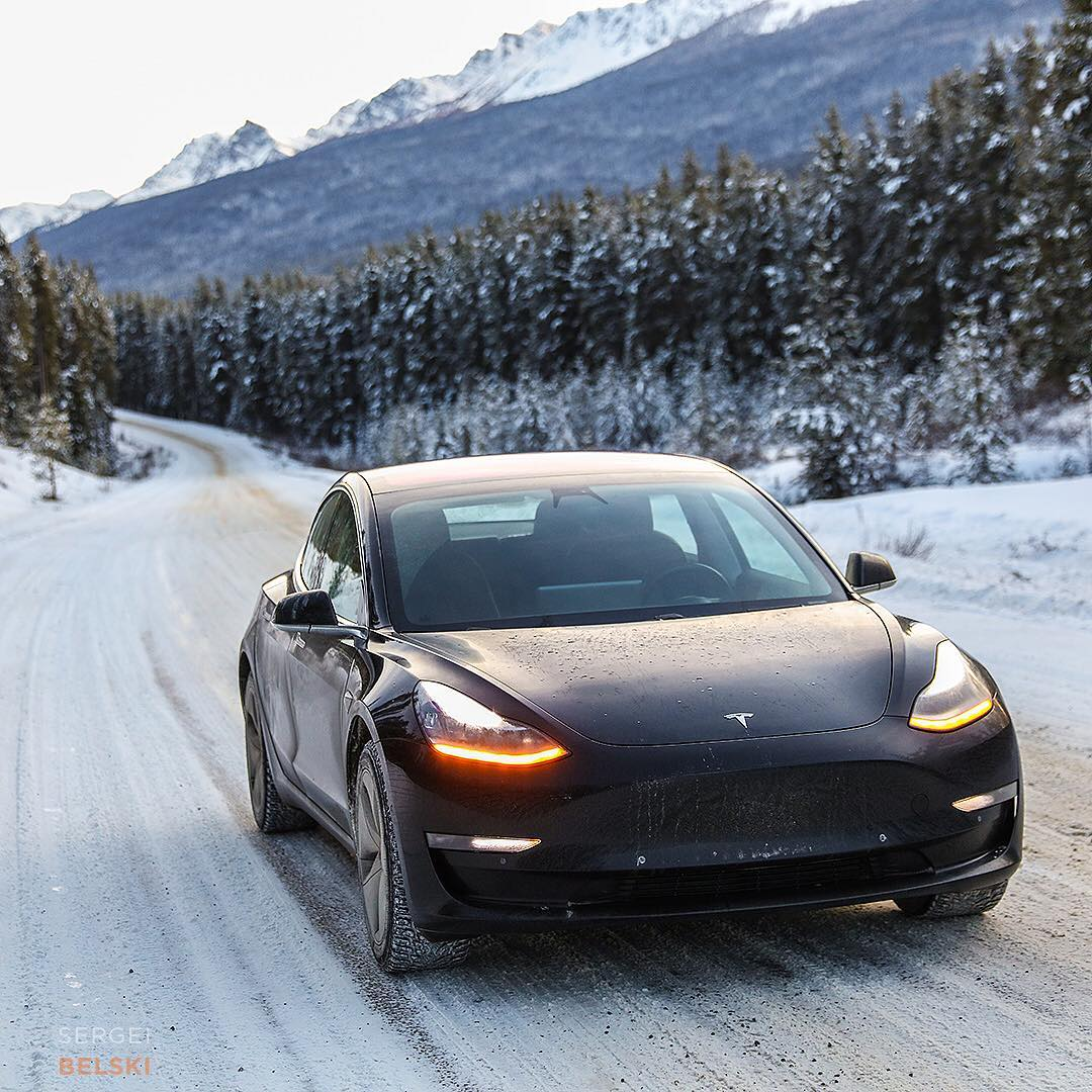 Driving a black Tesla Model 3 in Snow