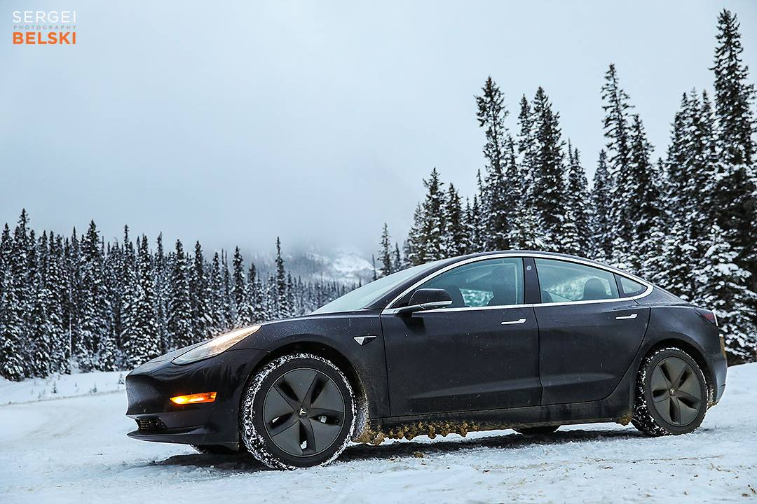 Black Tesla Model 3 in Snow - Front Side View