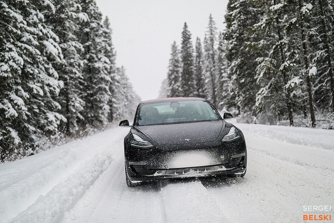 Driving a black Tesla Model 3 in Snow like a pro