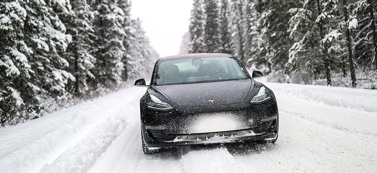 Tesla Model 3 in snow with winter tires