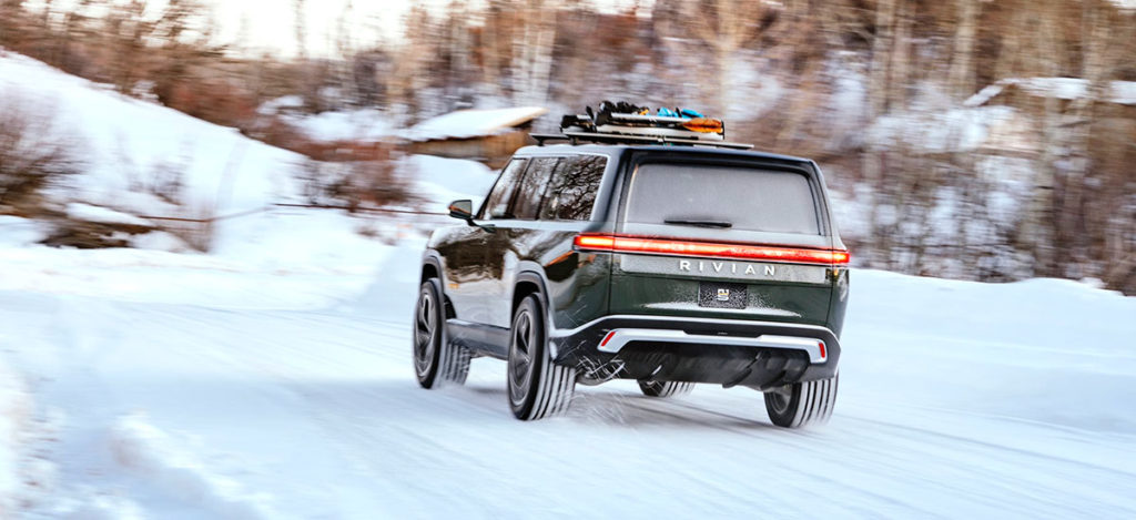 Rivian R1S cruising in the snow effortlessly