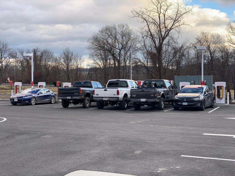 Tesla Supercharger blocked by Hillbilly Pickup Trucks